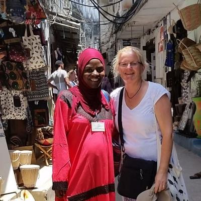 A Projects Abroad volunteer meets up with local woman during her English language course in Tanzania